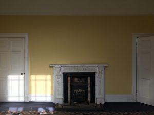 Fireplace on yellow wall