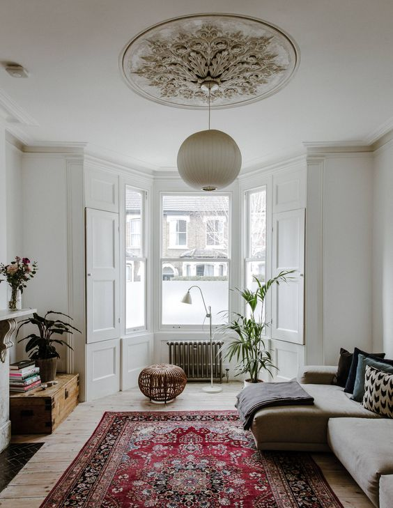 Living room with oversized rug and bay window